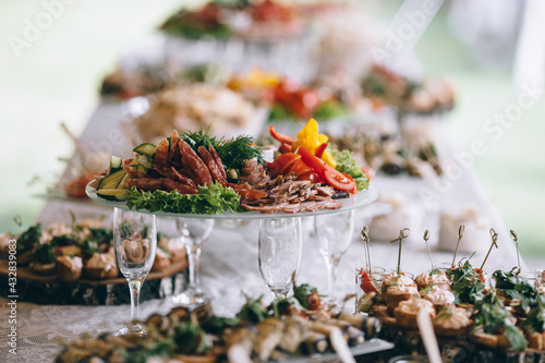 Leinwand Poster Beautifully decorated catering banquet table with different food snacks and appe