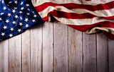 Fototapeta Kawa jest smaczna - Happy memorial day concept made from american flag on old wooden background.