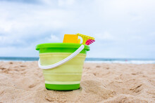 Beach Toys On The Sand With Towel