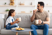 Cheerful Little Daughter And Dad Having Breakfast