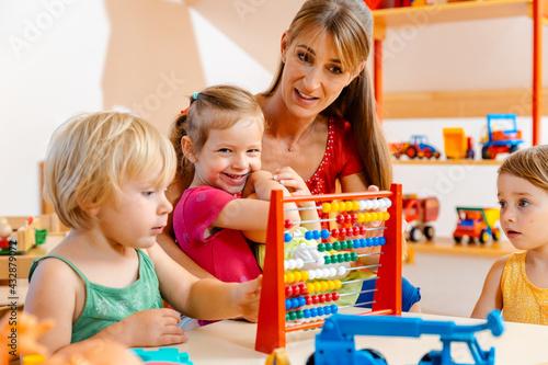 Wallpaper Mural Preschool teacher playing with the children