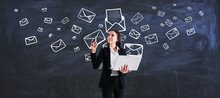 Mailing List And Marketing Concept With Young Woman With Laptop On Blackboard Background With Envelopes And Letters.