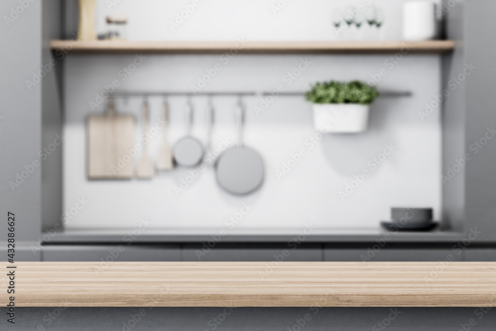 Leinwandbild Motiv - peshkov : Modern light wooden tabletop with copyspace for your text at blurry kitchen utensils and dishes on grey wall background. 3D rendering, mock up