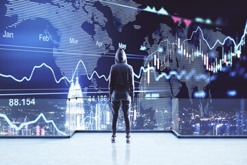 Investing and analyzing concept with back view on person in sport suit looking at digital screen with financial chart graphs over night city.