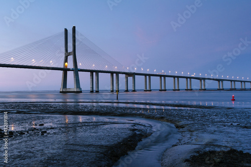 Amazing view of  Vasco da Gama Bridge at sunset. The Vasco da Gama Bridge crosses the Tagus River and is one of the longest bridges in the world. Lisbon. Portugal. #432891814
