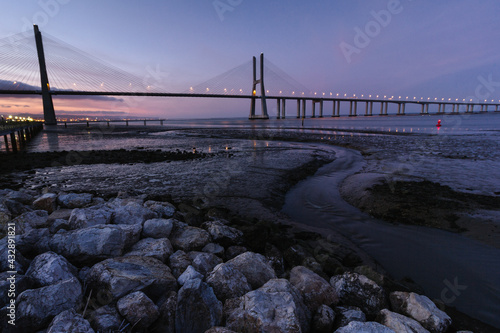 Amazing view of  Vasco da Gama Bridge at sunset. The Vasco da Gama Bridge crosses the Tagus River and is one of the longest bridges in the world. Lisbon. Portugal. #432891821