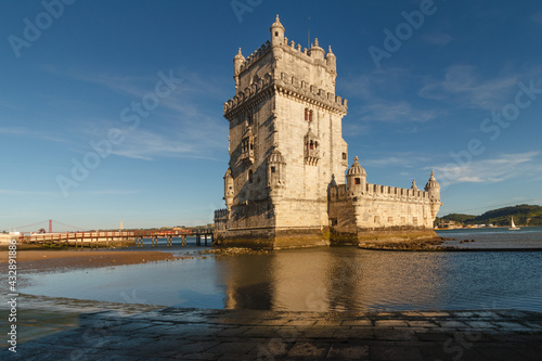 Belem Tower is a fortified tower on the Tagus river at sunset. Lisbon. Portugal. UNESCO World Heritage Site. Top tourist attraction in Europe. Concept of travel and tourism. #432891886