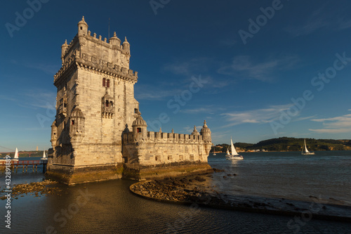 Belem Tower is a fortified tower on the Tagus river at sunset. Lisbon. Portugal. UNESCO World Heritage Site. Top tourist attraction in Europe. Concept of travel and tourism. #432891889