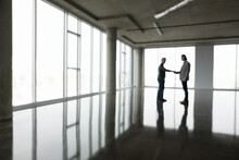 Businessman Receiving Keys For New, Empty Office Space
