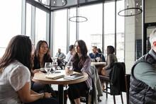 Businesswomen Talking At Business Lunch In Restaurant