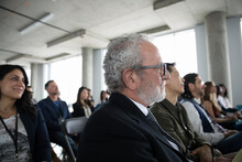 Attentive Businessman Listening In Conference Audience