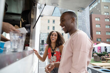 Happy Couple Ordering From Urban Food Truck