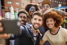 Diverse Happy Young Friends Taking Selfie With Camera Phone