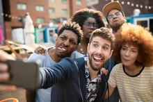 Playful Millennial Friends Making Faces, Taking Selfie At Urban Bazaar