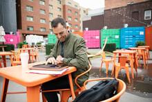 Real Estate Developer With Digital Tablet Working At Urban Bazaar Mark