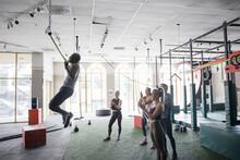 Cross Training Class Watching Man Do Pull Ups In Gym