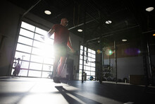 Man Jumping Rope In Sunny Cross Training Gym