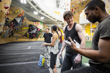 Young Climbers Chalking Up Hands In Climbing Gym