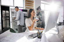 Interior Designer Working With Digital Devices In Showroom Office