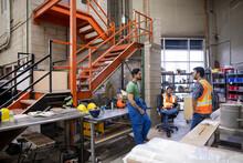 Workers Taking Break In Distribution Warehouse