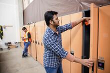 Worker Using Locker In Distribution Warehouse