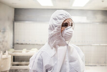 Portrait Of Worker Wearing Protective Clothing In Workshop