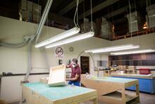 Carpenter Building Wooden Drawer In Workshop