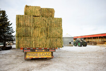 Trailer Loaded With Straw Bales On Farmyard