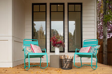 Turquoise Metal Rocking Chairs On Luxury Home Showcase Porch