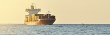 Large Cargo Container Ship Leaving The Port Of Norfolk At Sunset, Close-up. Virginia, USA. Freight Transportation, Logistics, Industry, Global Communications Theme