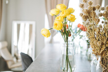 The Bouquet Of Peach Roses In Glass Vase On Table. Florist Working Place
