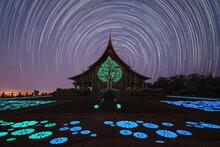 Wat Sirindhorn Wararam Or Wat Phu Prao Temple With Star Trail At Night In Ubon Ratchathani, Thailand. Buddist Temple. Tourist Attraction Landmark At Night. Light Illumination.