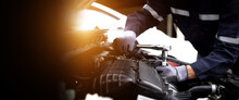 Auto Mechanic Working On Car Engine In Mechanics Garage.Repair Service,car Service, Repair, Maintenance Concept.