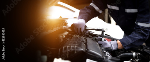 Fotografia, Obraz Auto mechanic working on car engine in mechanics garage