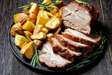 Whole Roasted Pork Loin With Baked Potato Wedges