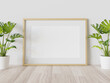Golden frame leaning on floor in interior mockup. Template of a picture framed on a wall 3D rendering