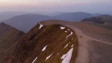 Helvellyn Summit Dawn Lake District UK.