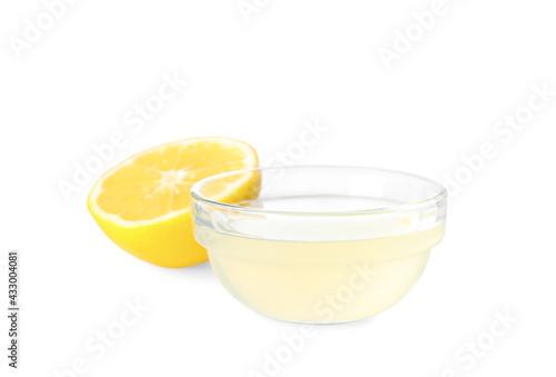 Obraz Freshly squeezed lemon juice on white background - fototapety do salonu