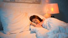 Preteen Kid Sleeping On Bed During Night