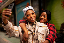 Portrait Of A Happy Smiling Female Friends. Beautiful Happy Girlfriends Taking A Selfie Together