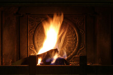 Firewood Burns In The Fireplace. Shooting At Night. Closeup