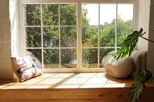Bright Scandinavian Room Interior With Green Plant Monstera And Sunlights, White Window Sill, Pillows