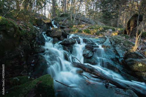 Long exposure photo of a beautiful waterfall in the Swedish forest Fotobehang