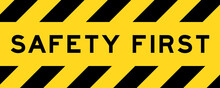 Yellow And Black Color With Line Striped Label Banner With Word Safety First