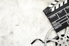 Motion Picture Film Reel With Movie Clapper. Cinema Concept