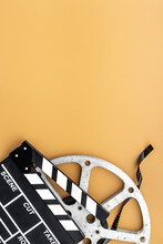 Big Film Reel With Movie Clapperboard, Top View. Cinema Concept