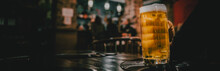 Man Hold A Glass Of Beer In His Hand At The Bar Or Pub