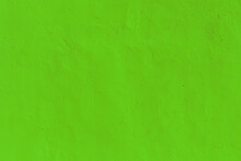 Bright Green Texture Of A Plastered Wall In A Modern Style. Neon Background For Design And Decor
