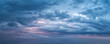 Leinwandbild Motiv Dramatic overcast sky at evening panoramic shot. Scenic blue gray clouds before the storm. Scenic cloudscape before the rain. Blue hour stormy cloudscape. Dark thunderstorm sky wide image.