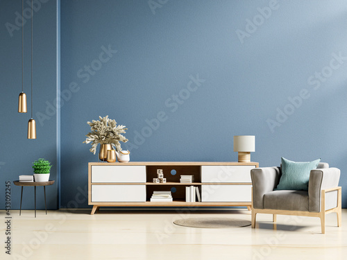 Fotografie, Obraz Modern interior of living room with cabinet and armchair on dark blue wall background